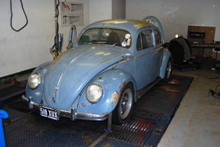 Old looking VW Beetle...